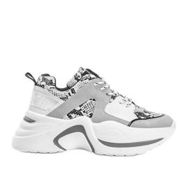 Białe sneakersy Thenisse
