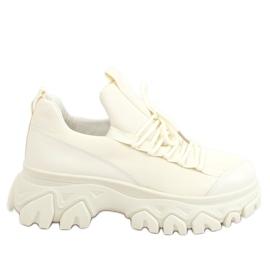 Buty sportowe na wysokiej podeszwie beżowe NB520P Beige beżowy