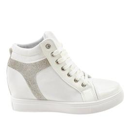 Białe sneakersy na koturnie z cekinami AN2959