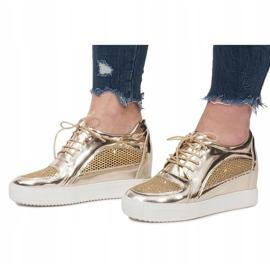 Złote Lakierowane Ażurowe Sneakersy Adele złoty 1