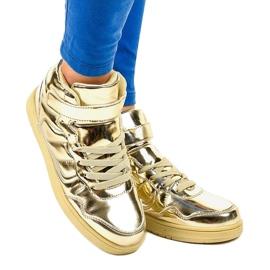 Złote Lakierowane Sneakersy XW7082 złoty 1