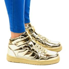 Złote Lakierowane Sneakersy XW7082 złoty 2