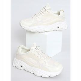 Buty sportowe damskie beżowe NB373P Beige beżowy 1