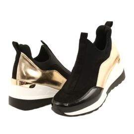 Wsuwane Sneakersy na koturnie Evento 21PB35-4000 czarne złoty 2